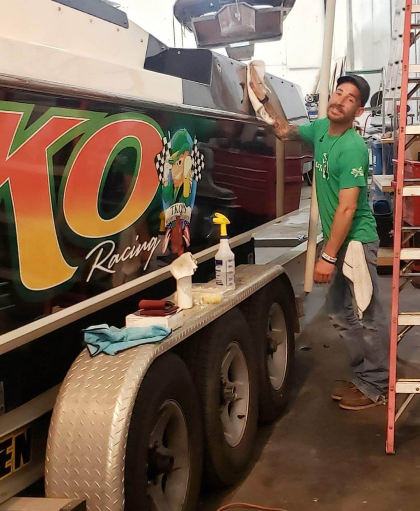 Gary polishing a boat